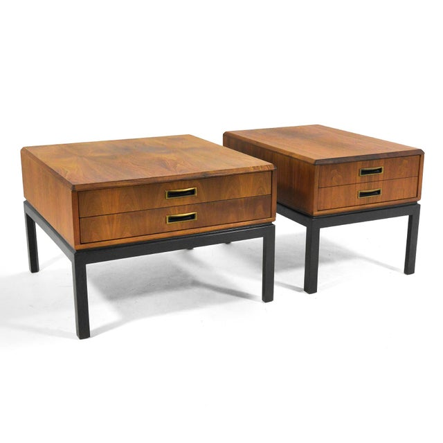 This handsome pair of side tables or nightstands by Harvey Probber features walnut cases with two drawers and attractive...