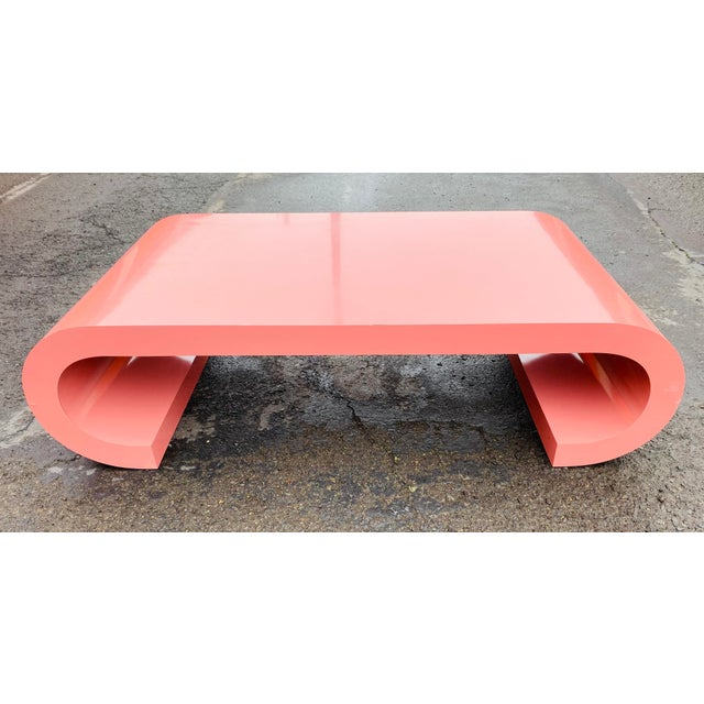 Amazing circa 1980s pink laminate scroll or waterfall coffee table. An incredible vintage find that is extremely on trend...