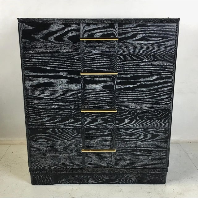 Handsome pair of breakfront chests in ebonized and cerused oak. This fine pair of chest have dovetailed oak drawer boxes...