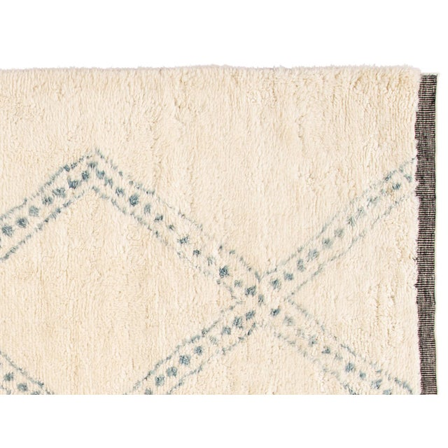 A hand-knotted modern Moroccan rug with a geometric design. This piece has great detailing and colors. It would be the...