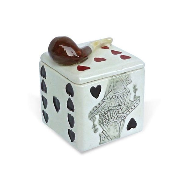 An antique 19th century ceramic playing cards and pipe box with lid. Each side has a different type playing card, and...