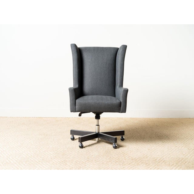 Upholstered swivel chair. Amalfi 100% Polypropylene. Raw coal matte finish on wood legs. MicroSeal stain and fade protection.