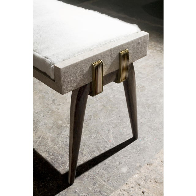 The pianist stool has subtle and elegant details on it's legs, with palm wood and cream shagreen inlay. The bronze-patina...