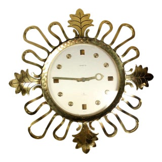 Semca Mid-Century Modern Bronze Sunburst Clock Made in Switzerland For Sale