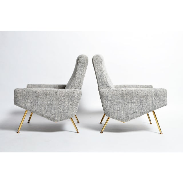 Handsome pair of French Airborne Edition armchairs designed by Pierre Guariche in the 1960s. Wide arm rests with slender...