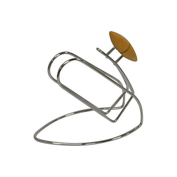 """French 1960's wine bottle carrier, """"porte bouteille"""". Mid century pointed handle and sleek stainless circular MCM body...."""