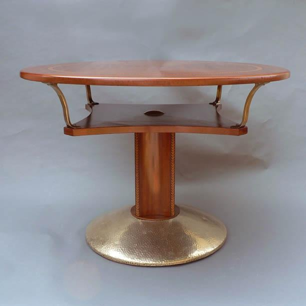 A very unusual Austrian Secessionist period circular game table having two tiers, and a four-sided concave pedestal, with...