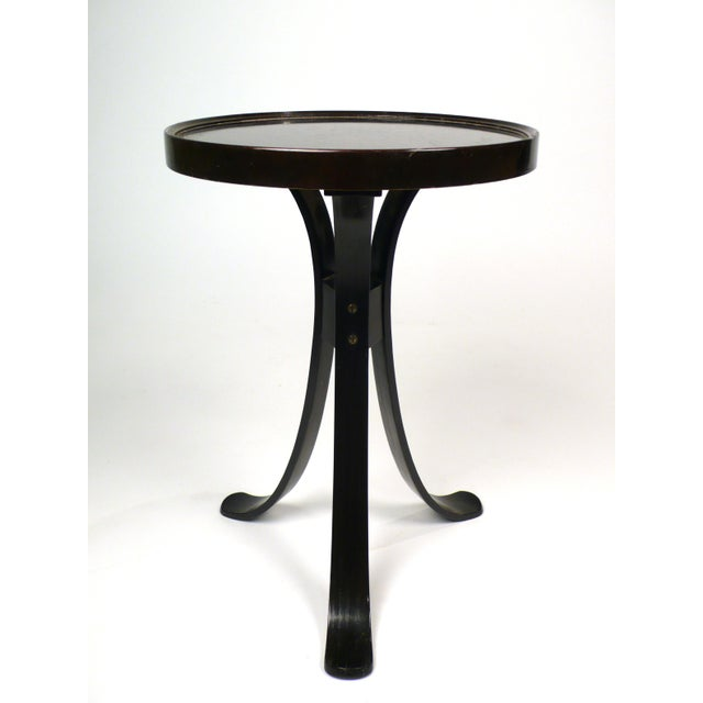 Side table by Edward Wormley for Dunbar. Very graceful, has slightly raised edge on top.