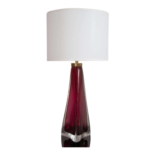 A stunning pair of Orrefors crystal lamps with a sculptural shape in a stunning garnet color, Swedish, circa 1960.