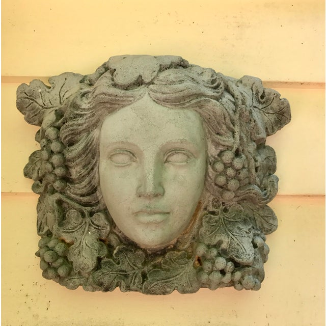 Architectural antique stone sculpture of a beautiful and serene Goddess entwined with exquisite carved vines and grapes....