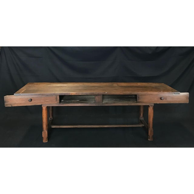 A spectacularly aged oak farmhouse table from the French countryside near Lyon, made around the early 1800s. The table has...