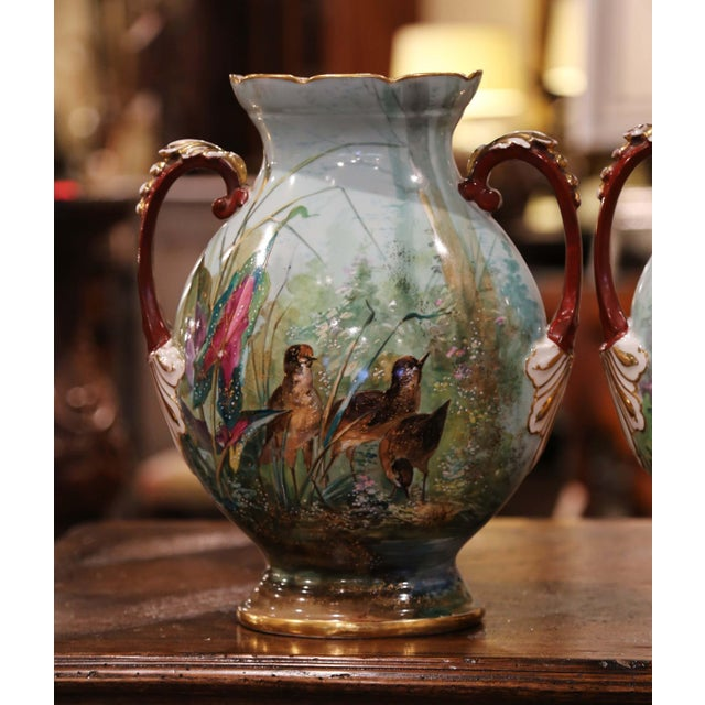 These elegant and colorful antique vases were created in Paris, circa 1870; oval in shape with a wide mouth and side...