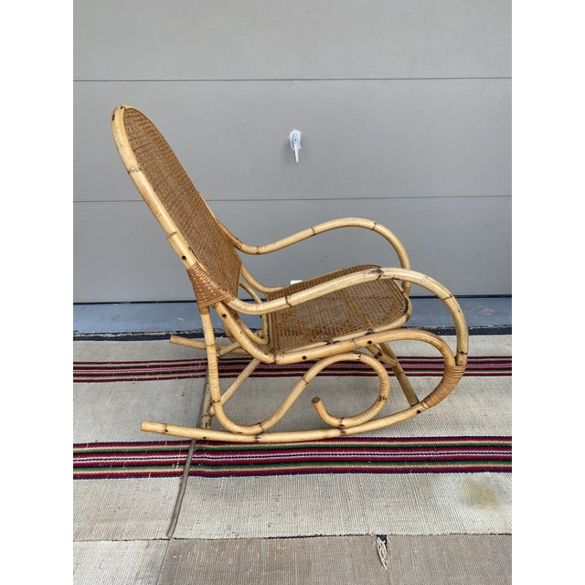 A Vintage Mid Century Modern Tiki Bent Bamboo Wood Rocking Chair 1960's Probably made in Hong Kong in the 1950's or 1960's...