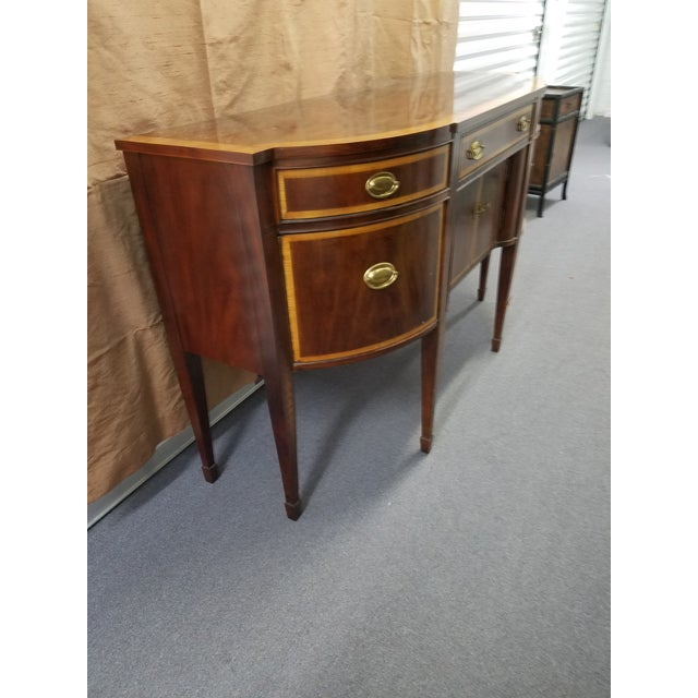 Exquisite piece of 18th century design by one of top craftsman with inlaid banding and marqueterie on tapered legs. Brass...
