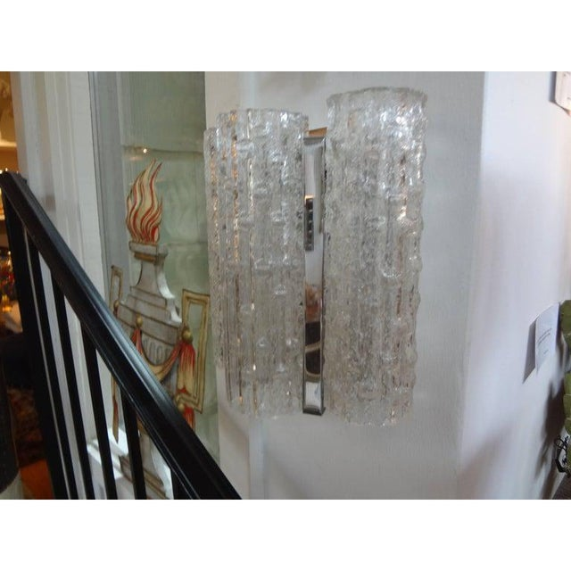 Pair of Italian Mid-Century Modern Venini style Murano glass sconces with chrome bases. These Murano sconces or Venetian...