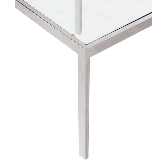 Nice mid-century modern chrome and glass side table.