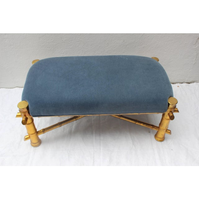 Gilt faux bamboo bench upholstered in blue mohair fabric.