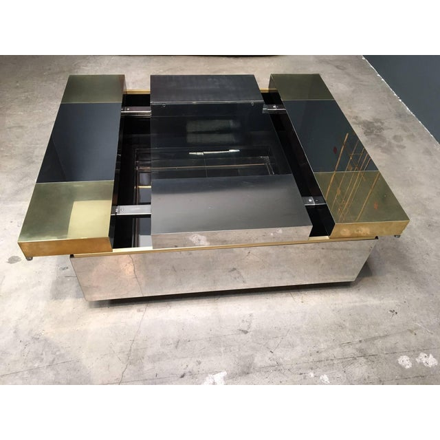 Italian coffee table Attributed to Pierre Cardin. Top slides open for bar or display. Brass, stainless steel and glass...