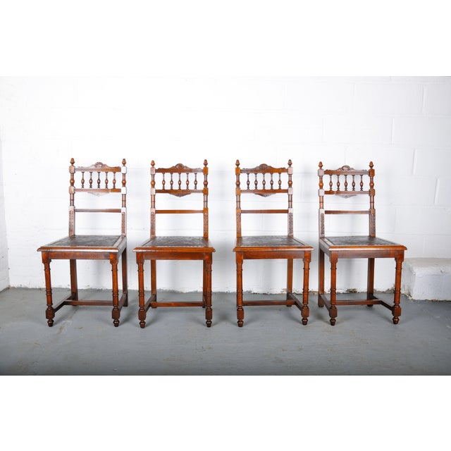 Set of 4 French Henri II dining chairs made of solid Oakwood. This set features solid construction, hand-carved details,...