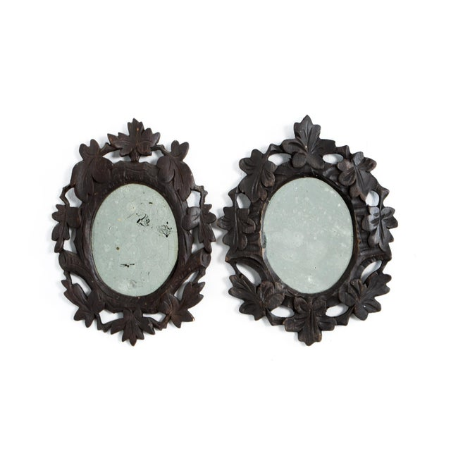 From the Black Forrest, circa 1920. Likely inspired by surrounding flora, these frames are carved from hardwood in...