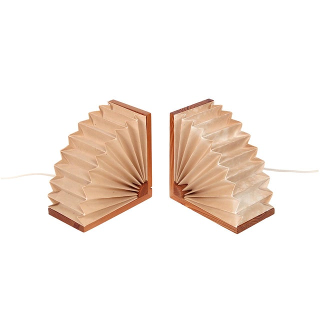 Accordion style pair of table lamps or wall sconces by American designer Noah Slutsky. Parchment paper shades attached to...