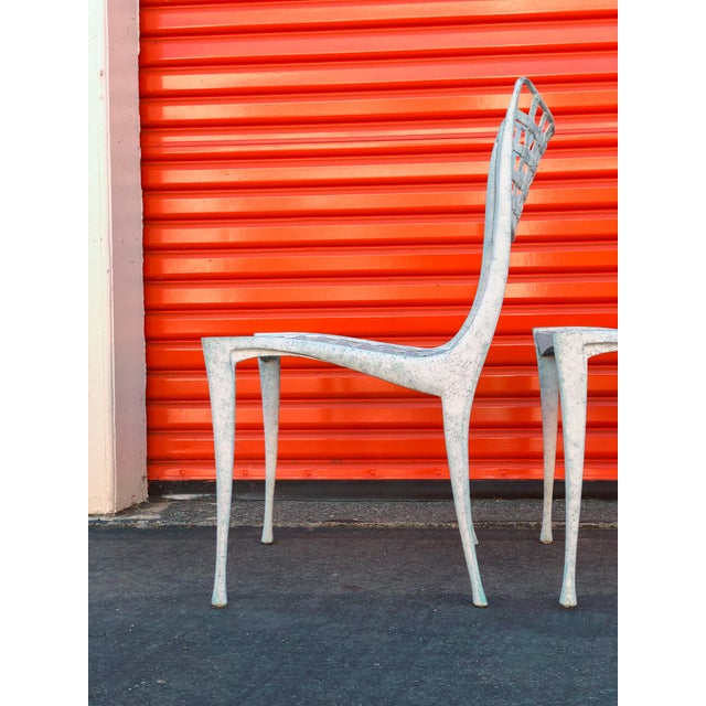 Set of 4 iconic cast aluminum chair designed after Dan Johnson's gazelle series manufactured by Brown Jordan. The chairs...