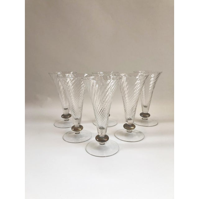 "Set of six unique French Art Deco tall trumpet shaped crystal glasses with 22 karat gold decorated stems. Dims: 4.25"" Dia..."