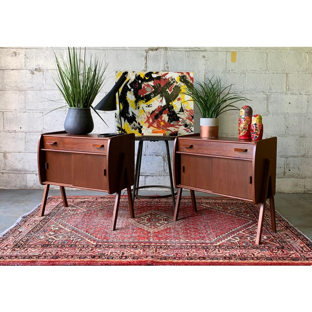 Pair of Mid Century Modern teak cabinets with sliding doors and single drawer. Perfect as bedside cabinets or storage...