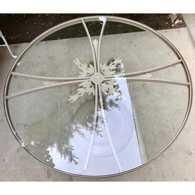 Palm Beach style Brown Jordan garden or patio table featuring a faux bamboo painted iron frame. A Chinese Chippendale...