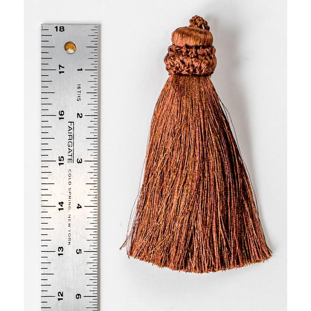 This copper colored tassel was custom made in Thailand. The piece is extra thick and is 5 1/2 inches.