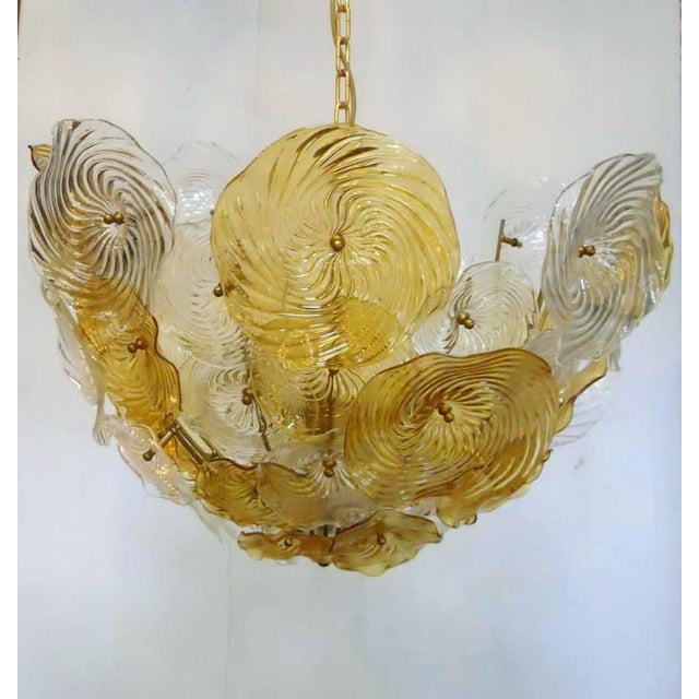 Vintage Italian amber and clear Murano glass discs chandelier. / Made in Italy in the 1960's 5 lights / max 40W each...