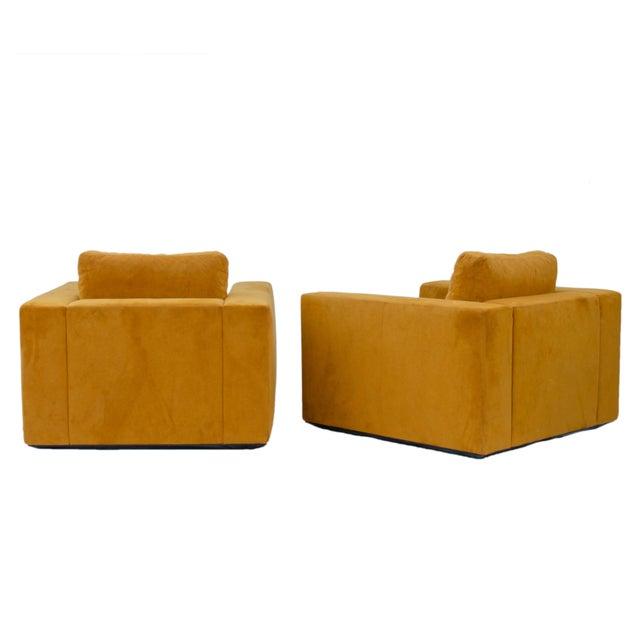 A pair of suede Reid Armchairs by Jeffrey Bernett & Nicholas Dodziuk for Design Within Reach. Orange brown color. 37...