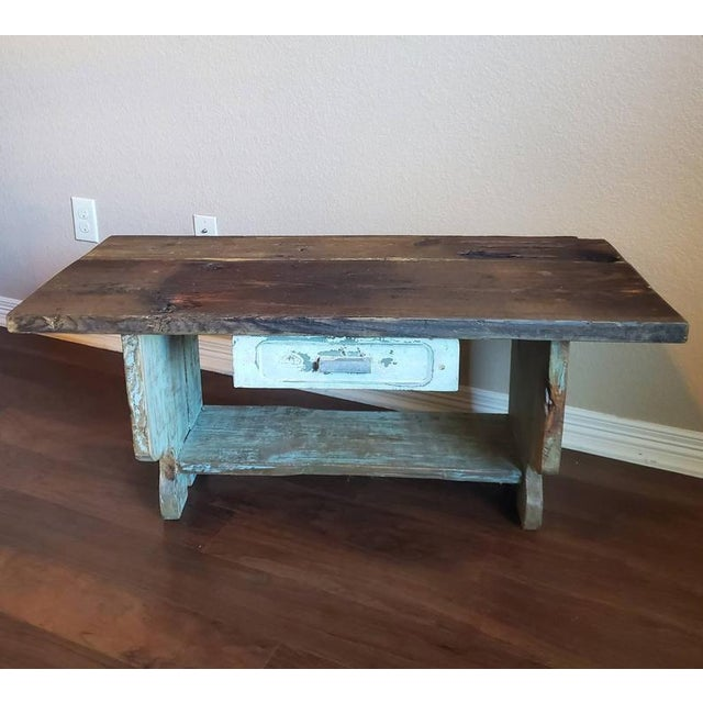 An old, rustic wooden multi-use work table / bench / stool originating from the Southwestern United States, likely on a...