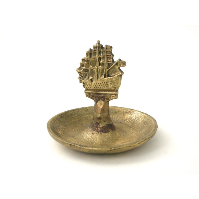 Vintage brass dish with detailed ship. Perfect for jewelry or change. Made from solid brass with a pebbled texture and...