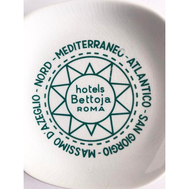 "Mid century ""Hotels Bettoja Roma"" Italy ashtray from Rome, Italy. Green hotel logo on white background. A cool mid century..."
