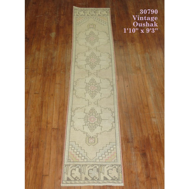 One of a kind hand-knotted mid 20th century turkish runner, narrow and long.