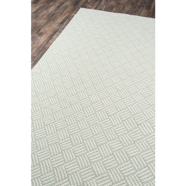 Soft green tones and an organic inspired pattern make this indoor/outdoor area rug perfect for outfitting a veranda, porch...