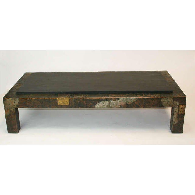 Large mid-century modern coffee table by Paul Evans for Directional. Patchwork metal with great patina and the original...