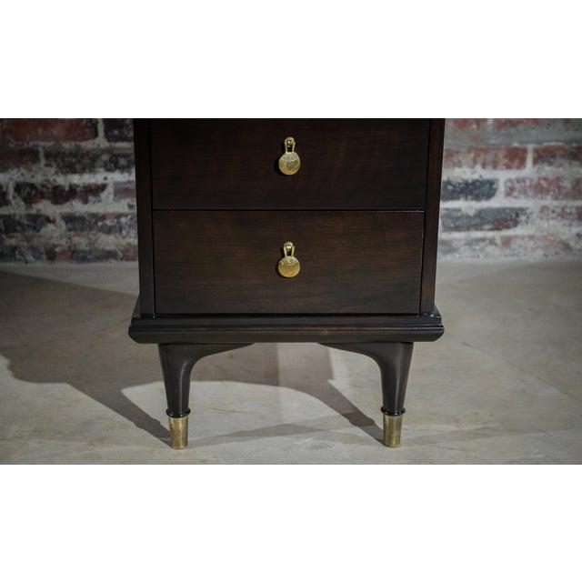Beautiful narrow nightstand by Johnson Furniture Company of Grand Rapids, MI. This piece was designed by Renzo Rutili. It...