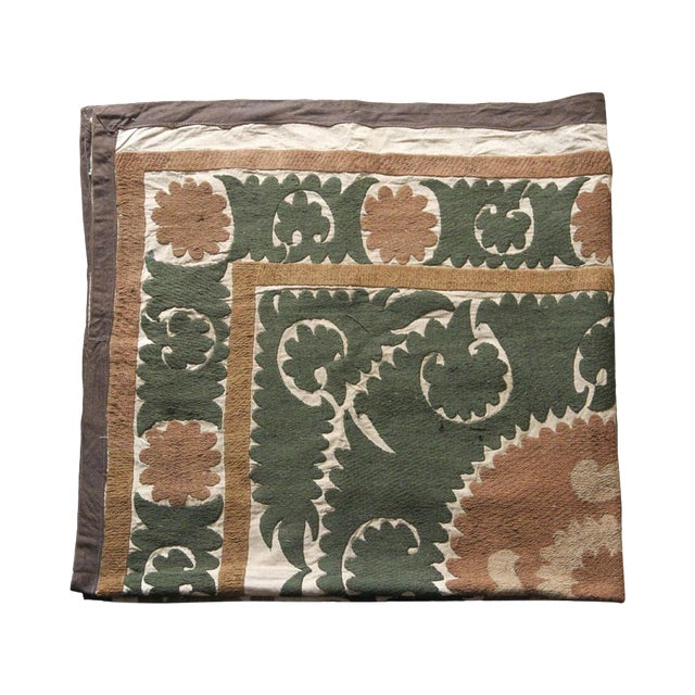 This suzani textile has been hand-embroidered by the nomadic people of Uzbekistan. Suzanis are highly regarded for their...