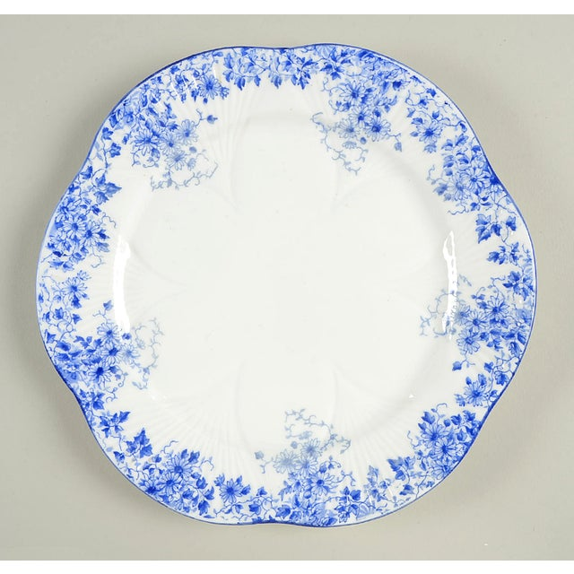 Shelley Dainty Blue Salad Plate Set/6 features dainty blue flowers and trim with a scalloped edge. Each plate has apparent...