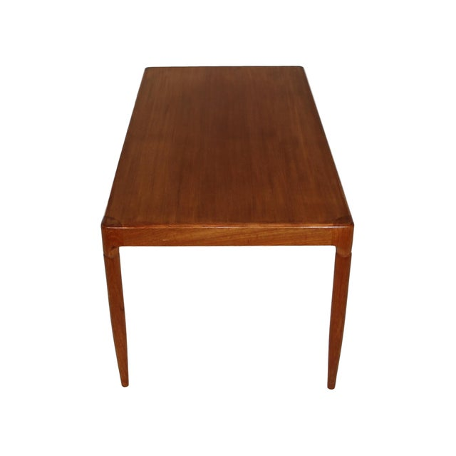 Stunning mid-century teak coffee table. Made in Denmark. Very good vintage condition. Minor wear consistent with age and...