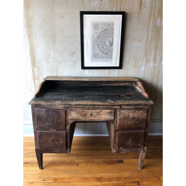 Rustic Tuscan antique office desk with raised back shelf. Below the table is a pull extension above a central drawer with...