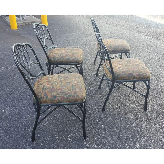 Stylish set of Mid-Century Modern dining chairs in true West Palm Beach style. Exquisitely detailed faux bois motif with...