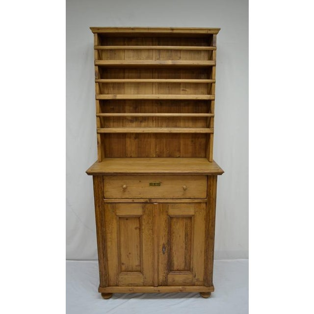 This tall and narrow pine open rack dresser is a marriage; that is, the pieces were not built to go together; but it is...