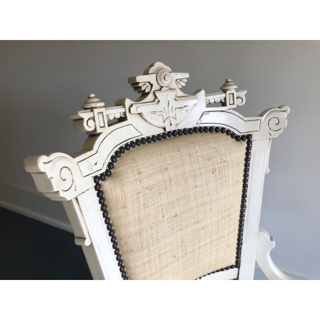This is a pair of ivory carved cottage chairs. They have Raffia fabric cushions and make a great addition to a dining...