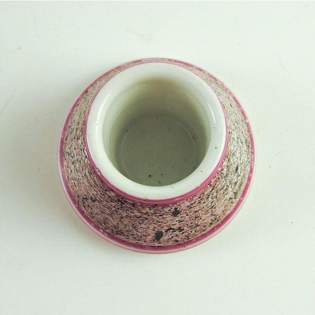 Circa 1900 porcelain match striker and holder. Pink border, no marks, overall wear to glaze.