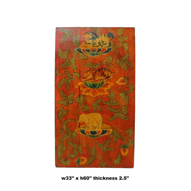 This is a vintage Chinese Tibetan accent wood panel in the door-like style. The base color is red and colorful stone...