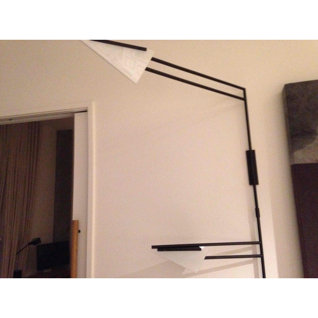 Very dramatic wall mounted swing arm lamp with two shades. Perfect for a Study or office. Plug in, professional wall...