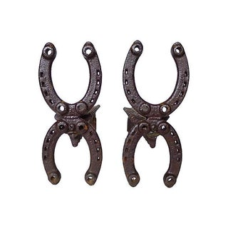 Vintage Horseshoe Andirons - A Pair For Sale